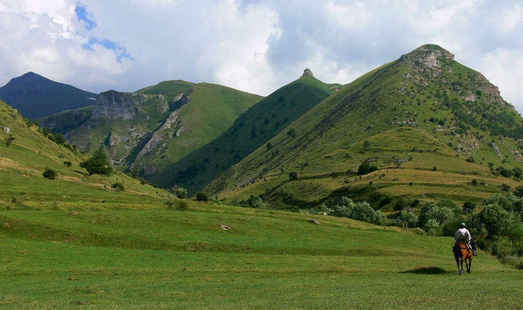 Horserider at Šar mountains (Шар-планина, Malet e Sharrit); Mt. Papka in the middle - Šar Mountains