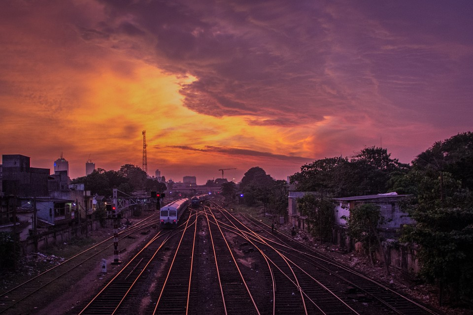 Dramatic Sunset over Railway Tracks -