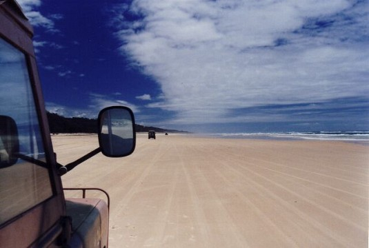Landrover on beach -