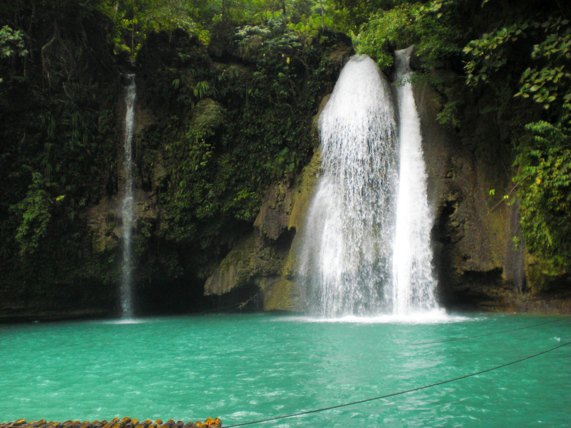 Description about kawasan falls in badian