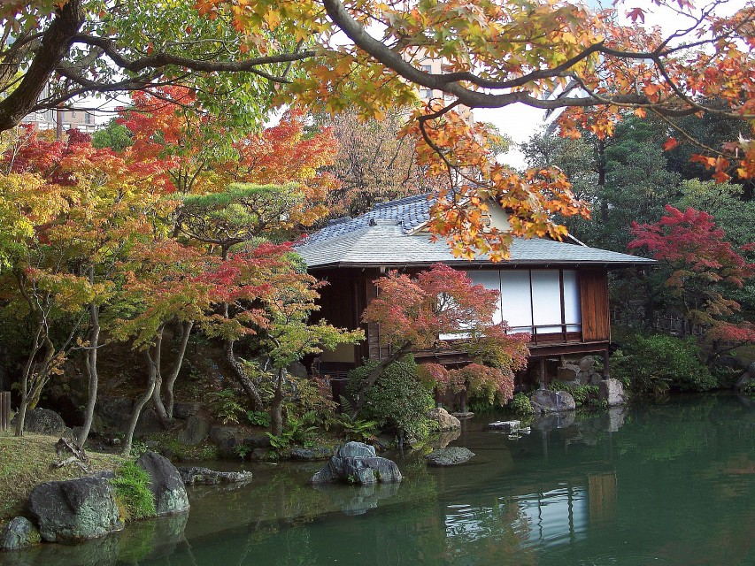 Japan (Kobe- Sorakuen Garden) Beatiful teahouse in garden surrounded with Autumn colored trees - Kobe