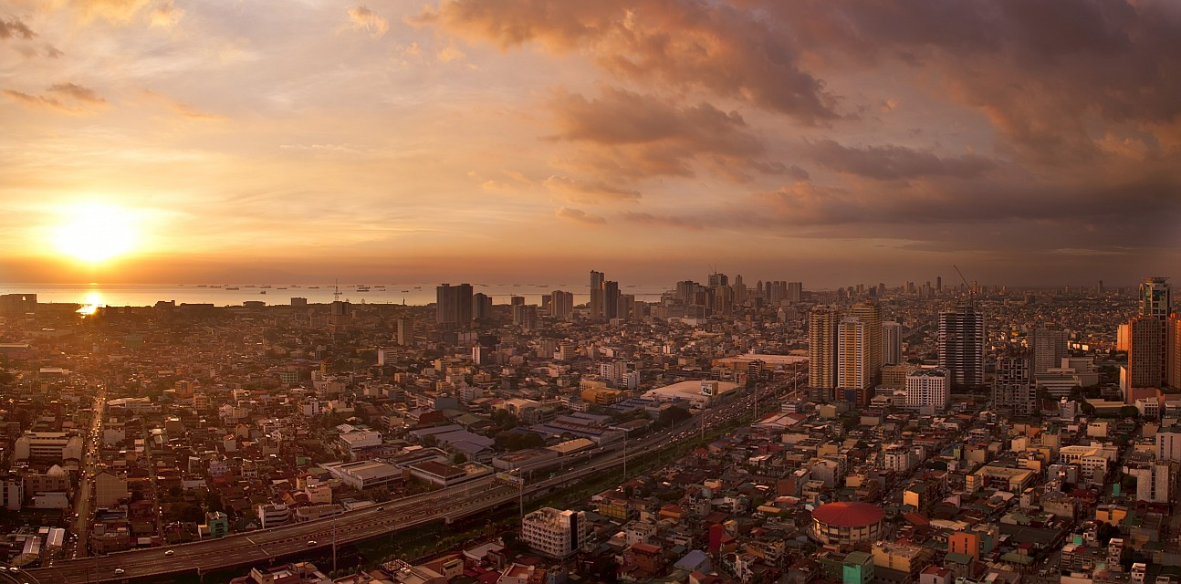 Pasay (left) and Manila (right, highrise) seen from Makati. Sunset. - Manila