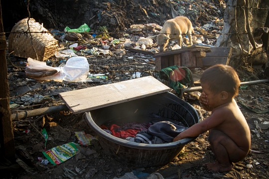 A child washing his face