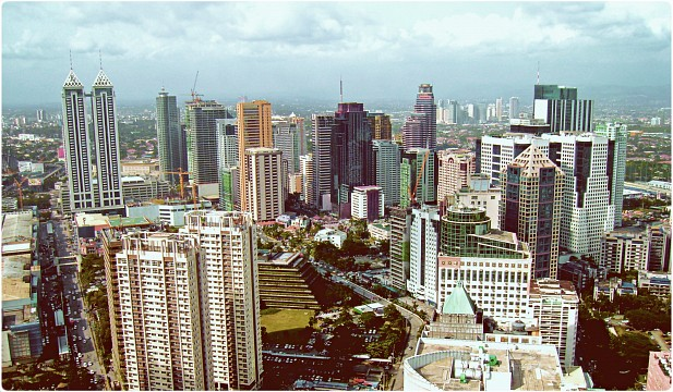 High-rises of Ortigas with terraced building of San Miguel Corporation in foreground - Ortigas