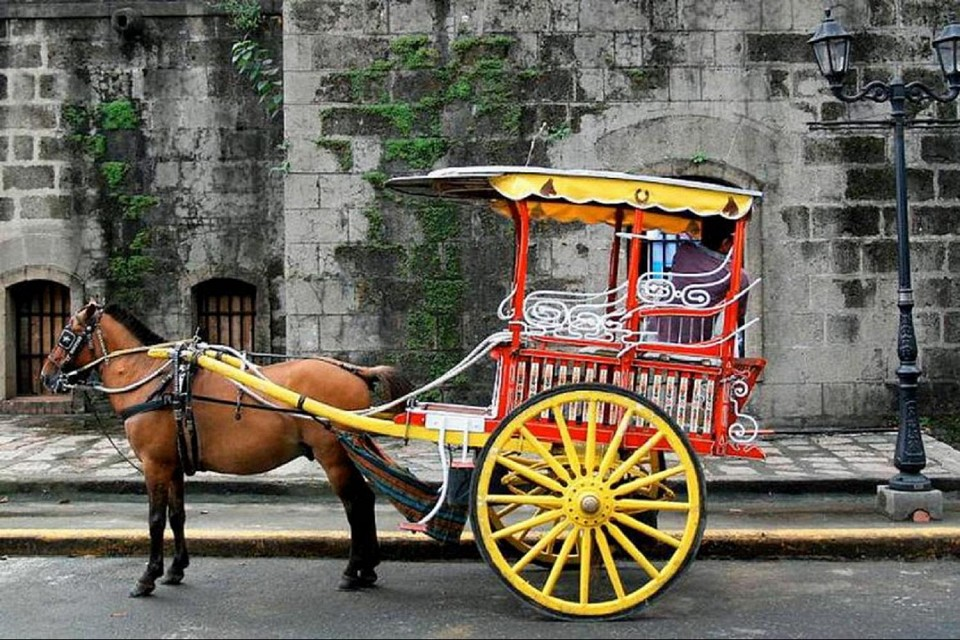 Calesa or Caretela (Horse-drawn Carriage) - Public transportation that started during the Spanish times and is still currently used in Manila and Cebu, Philippines - Philippines