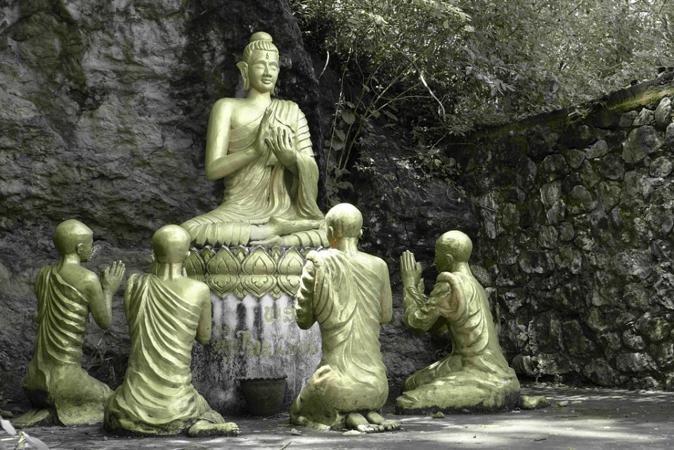 Lovely statue of buddha with monks - Phou Si