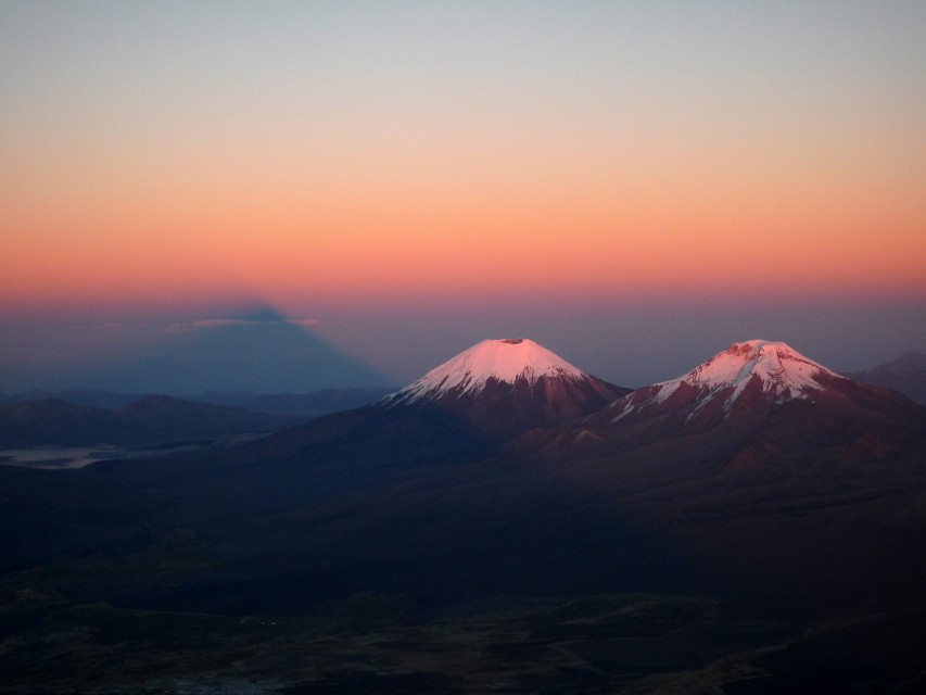 Shadow of Sajama at Sunrise with Parinacota and Pomerape - Pomerape