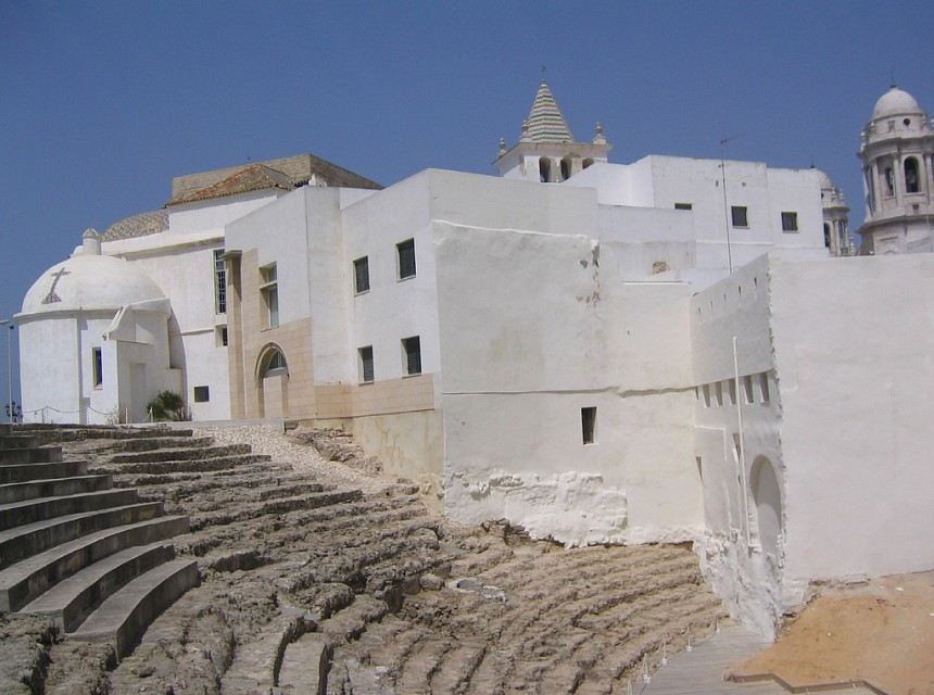 Ruins of a Roman theater beside a white house in Cádiz, Spain - Roman theatre of Cadiz