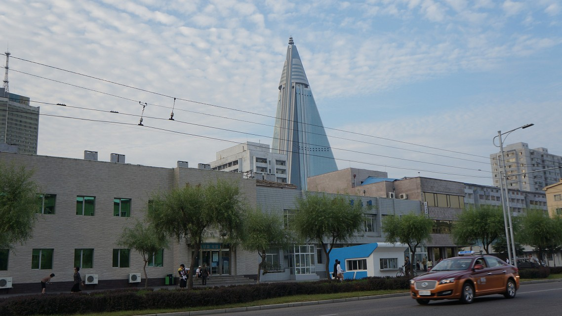 Pyongyang streets with Ryugyong Hotel in background - Ryugyong Hotel