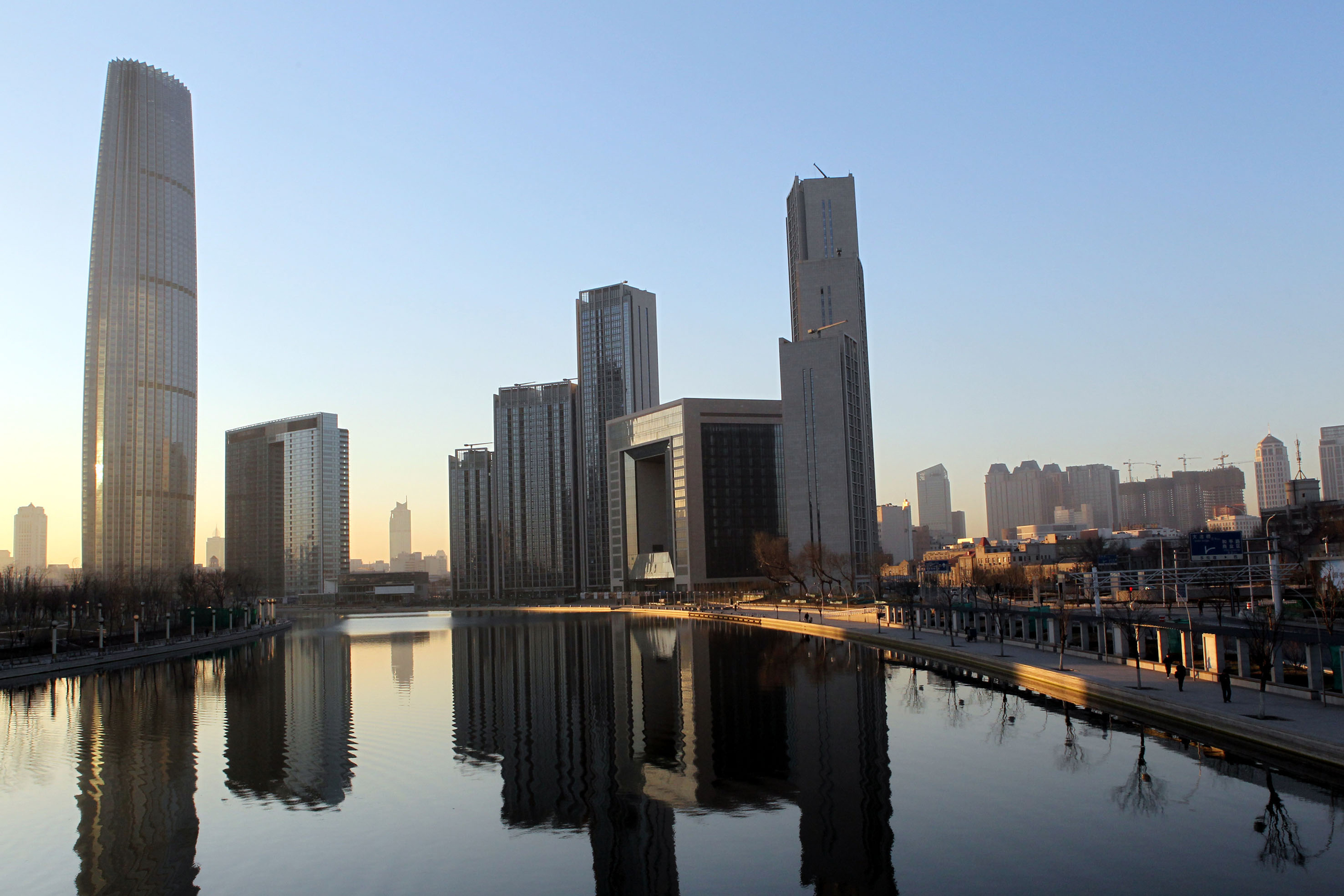 Haihe River, Tianjin World Financial Center on the left, St. Regis Tianjin (square building)