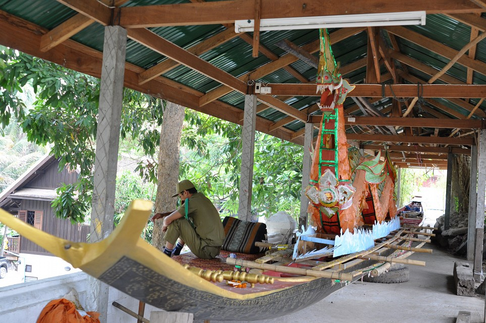 Long boats are stored near the rear entrance of Wat Xieng Thong - Wat Xieng Thong