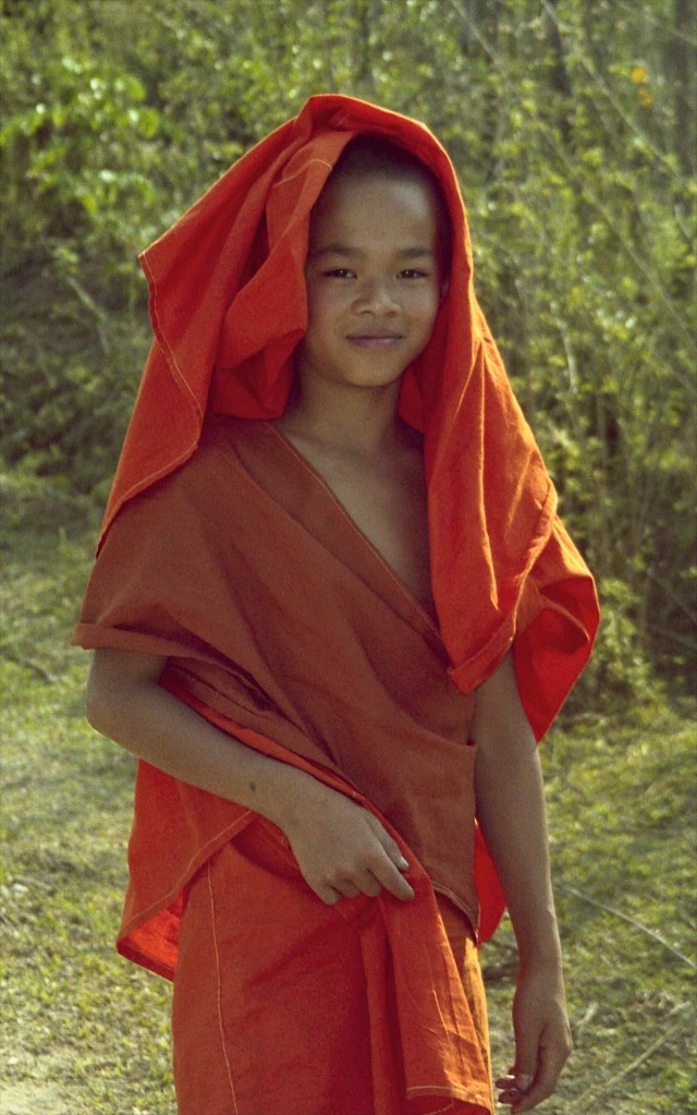 Young monk on road; S Xishuangbanna, Yunnan, China - Yunnan